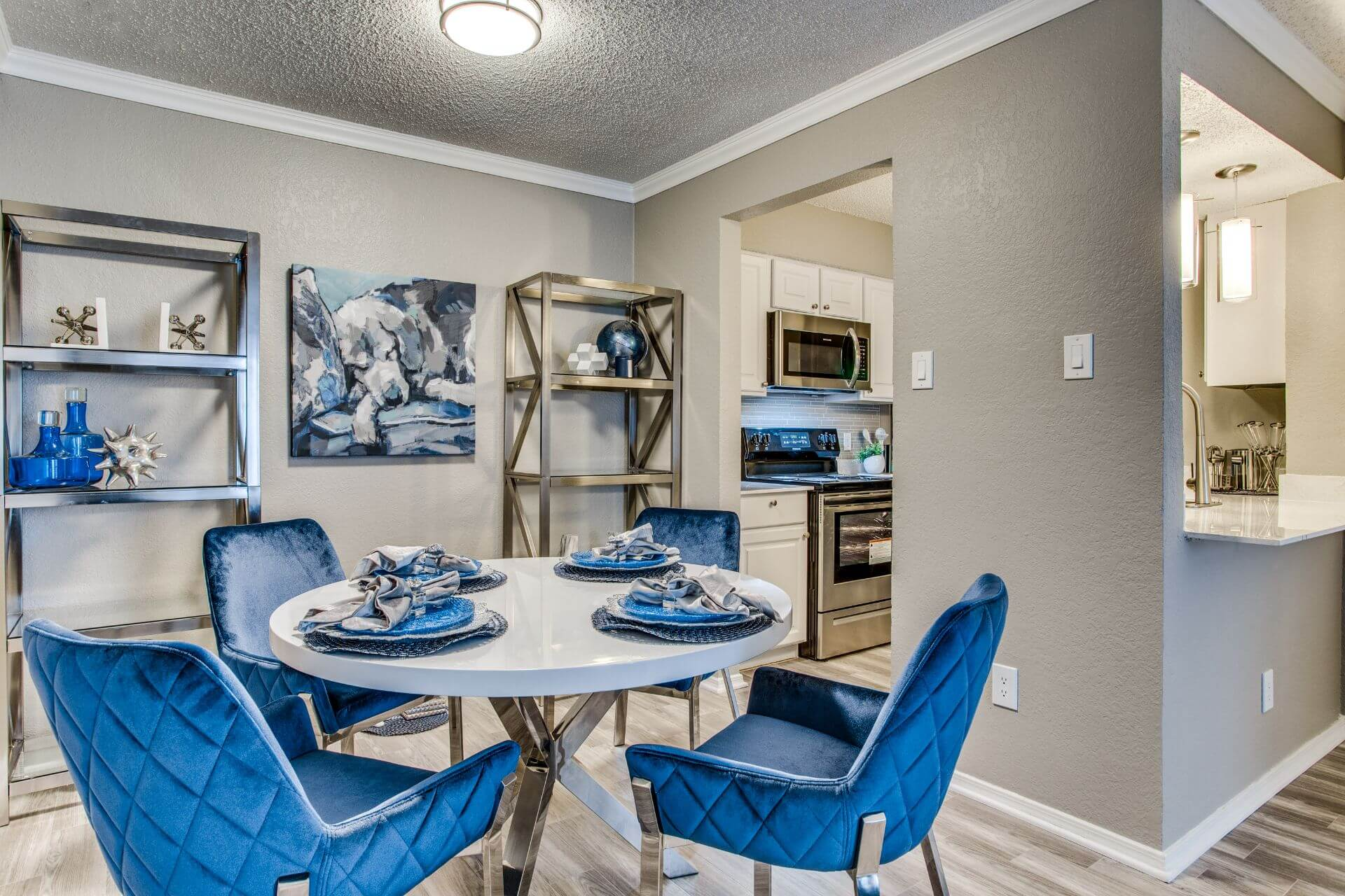 Dining room and kitchen of newly renovated model apartment at Devon on Northgate